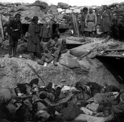 Russian_soldiers_stand_over_trench_of_dead_Japanese.jpg